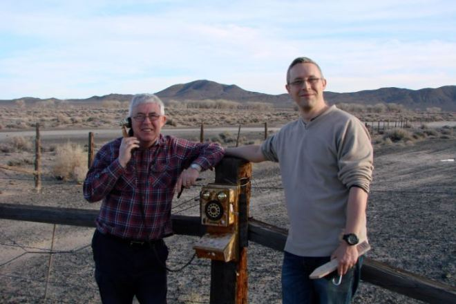 Wild Rover and frezeluberz taking the PAF option at a cache in the TS series in the Nevada desert.
