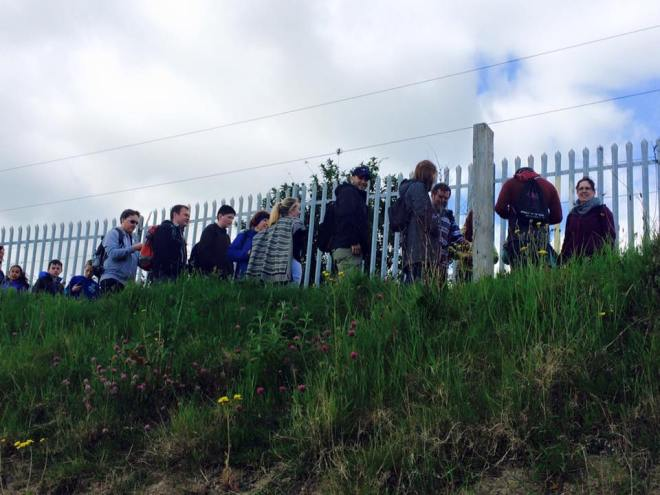 Geocachers hunt for a cache in Greystones, County Wicklow